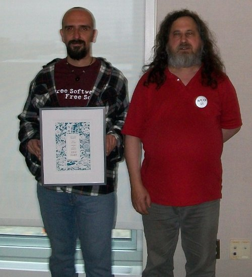 Fecon getting award from Stallman